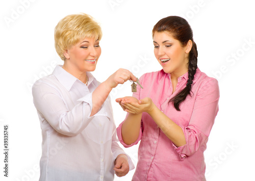 Senior woman give keys to young woman