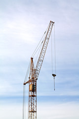 building crane on cloudy background