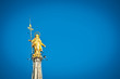 Golden Madonnina on the roof of Duomo cathedral. Milan, Italy.
