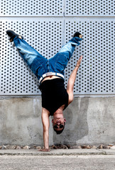 Young male dancer hip hop dancing urban scene