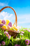 Fototapety decorated easter eggs in the grass with flower