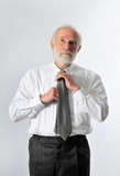 a businessman fixes his tie