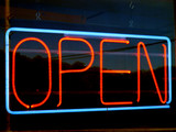 an image of open neon sign at night