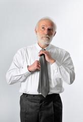 a businessman fixes his tie