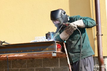 welder working outside in the metal construction, site