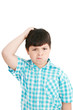 Boy scratches his head in puzzlement or confusion, as if ponderi