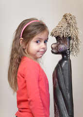 Little girl with ethnic doll