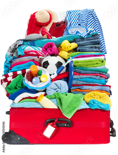 overloaded travel suitcase packed for vacation, luggage