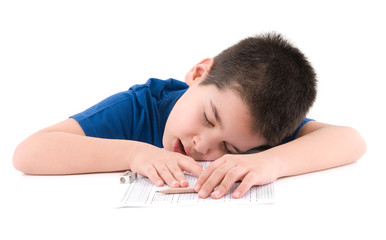 Cute boy sleeping during exam isolated on white background.