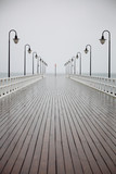 old pier in rain on Baltic sea Orlowo Gdynia Poland