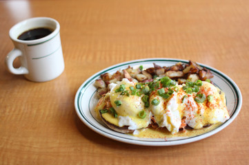 Eggs benedict with salmon and grilled potatoes.