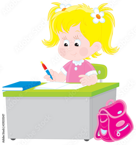 Schoolgirl writing a test in school