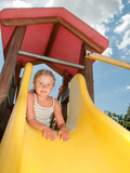Happy childhood - lovely girl on the playground poster