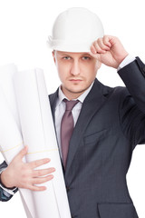 Engineer wearing white hardhat with blueprints isolated on white