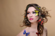 fashion beauty woman with eye make-up and butterfly