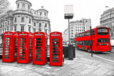 Red telephone boxes and double-decker bus, london, UK. - 39354761