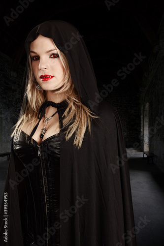 Female vampire in hooded cape