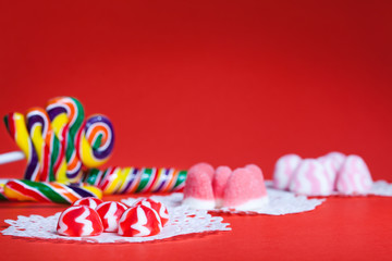 Candy assortment on red background