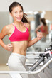 Woman running on treadmill gym