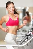 Woman running on treadmill gym