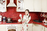 Housewife with cup and phone