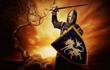 Fototapety Medieval knight over stormy sky.