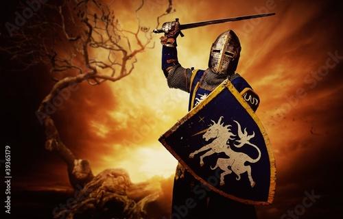Medieval knight over stormy sky.