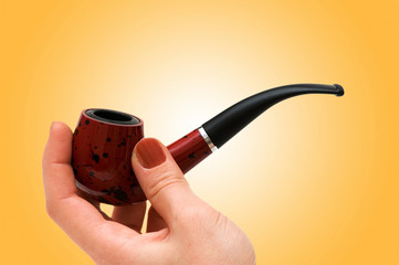 Hand with the smoking pipe