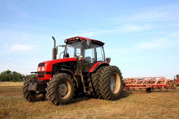 Tractor with a harrow