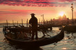 Gondolier against sunset in Venice, Italy