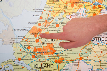 A Dutch map with a hand pointing to the governmental city The Ha