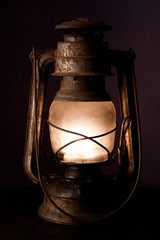 Old kerosene lantern burning with bright flame