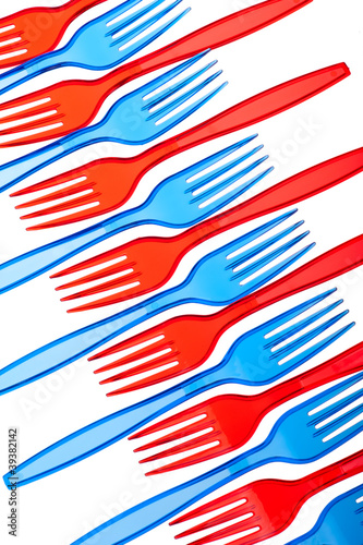 Disposable tableware. Set of colored plastic forks isolated