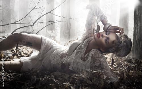Beautiful lady lying and posing - 39385166