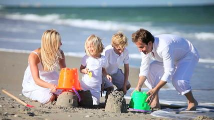 Young Caucasian Family Beach Fun