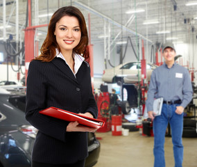 Woman manager in auto repair service.