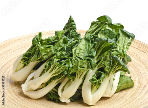 Bunch of Baby Bok Choy on a Bamboo Tray Isolated on White