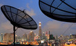 black antenna communication satellite dish over sunset sky in ci