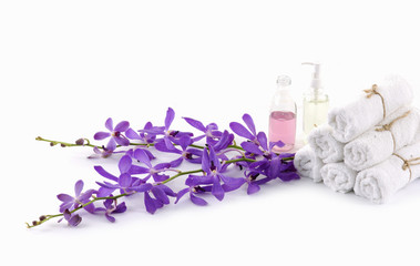 roller towel with branch pink orchids and massage oil