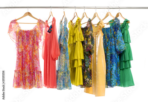 colorful clothes choice of casual clothes on wooden hangers