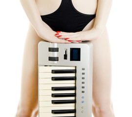 Part of Woman body with Piano keyboard.