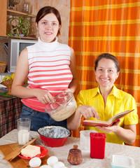women making celebration cake