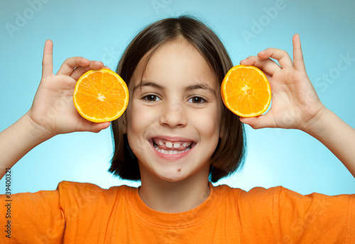 Little girl with oranges Poster