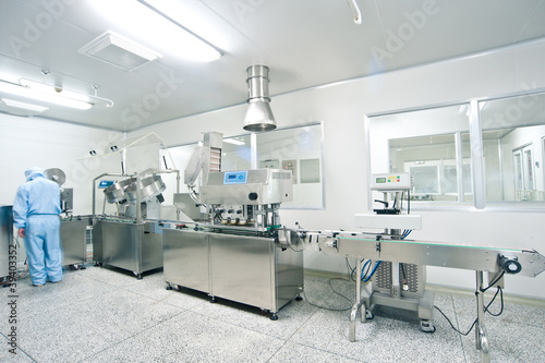 Technicians working in the pharmaceutical production line - 39403352