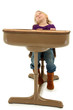 Adorable Sleeping Preschool Girl Child in School Desk