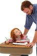 Teacher or Father Helping Elementary Student at Desk