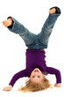 Beautiful Preschool Girl Child Laughing and Doing Hand Stand