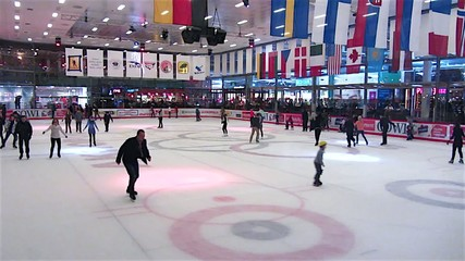 People skate on a skating rink