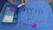 Surgeon preparing a stitching wire set