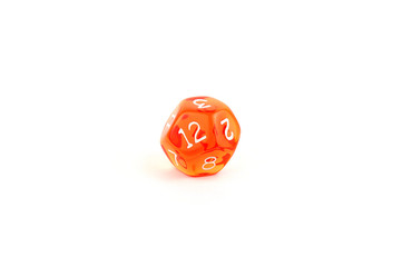 Photo of a translucent orange twelve-sided die on white